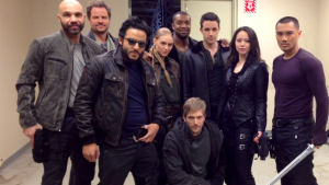 From left to right: Conrad Pla, Anthony Lemke, Ennis Esmer, Jessica Sipos, Roger R. Cross, Jon Cor, Marc Bendavid, Melissa O'Neil and Alex Mallari Jr.